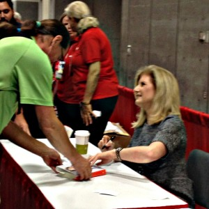 Arianna Huffington signing books after her keynote speech at AARP's Ideas@50+ convention in San Diego