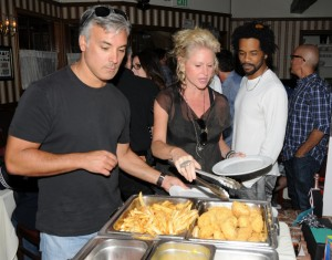 Mindi Abair (center) with her boyfriend Eric Guerra (left) serving up an English breakfast the buffett while Andre Berry (right) looks on (Photo by David Hopley)
