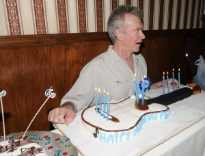 Peter White getting ready to blow out candles on his guitar-shaped birthday cake (photo by David Hopley)