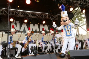 The Disneyland Band officially opened the NAMM show  with special guest conductor Mickey Mouse on the Grand Plaza at the Anaheim Convention Center on Jan. 22, 2015 in Anaheim, California (Photo by Jesse Grant/Getty Images for NAMM)