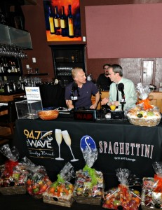 Cary Hardwick (Spaghettini co-owner) on air with Bill Dudley during 94.7 The WAVE's live broadcast from Spaghettini in Seal Beach, CA (Photo by David Hopley)