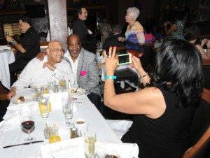 Lillian Perry snaps a photo of Phil Perry & Joey Sommerville at Spaghettini (Photo by David Hopley)