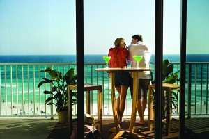 Couple enjoying a spectacular view of the Gulf of Mexico from a Resort Quest condo in Panama City Beach, Florida