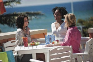 Ladies enjoying lunch and ocean view at a Pier Park eatery in Panama City Beach, Florida