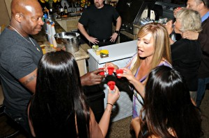 Camella Elliot toasting with shots of tequila at her 50th birthday party (Photo by David Hopley)