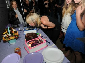 Mindi Abair blowing out candles on her birthday cakes (photo by David Hopley)
