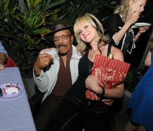 Sweetpea Atkinson (The Boneshakers) enjoying birthday cake & Mindi Abair on his lap (photo by David Hopley)
