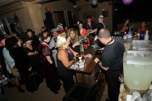 Kelly Cole & Lori Stoll belly up to the bar at the Elliot's Halloween Bash (Photo: David Hopley)