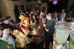 Halloween partygoers keep the bartender very busy (Photo: David Hopley)