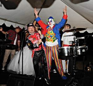 Richard Elliot, DW3 & clown onstage at the Elliot's Halloween Bash (Photo: David Hopley)