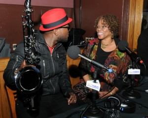 94.7 The WAVE's Pat Prescott interviews Barbados-born saxophonist Elan Trotman during a live broadcast during the Smooth Jazz News Anniversary Brunch & Jam Session at Spaghettini (photo by David Hopley)