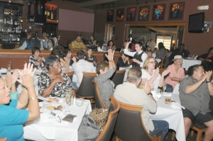 Crowd enjoying music & brunch in Spaghettini's lounge, which sold out during Smooth Jazz News' 16th anniversary brunch (photo by David Hopley)