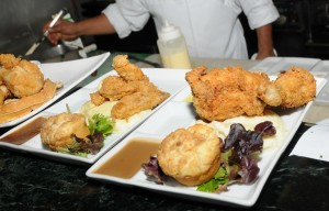 Buttermilk-fried chicken with biscuit & gravy and chicken and waffles are two popular menu items that are served at Spaghettini's brunch in addition to their buffet! (photo by David Hopley)